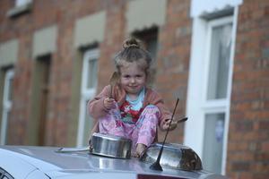 Three-year-old Elsie McGuiness makes some noise in Henderson Avenue in North Belfast