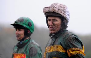 CHEPSTOW, WALES - NOVEMBER 06:  A muddied Tony McCoy (R) looks on after a race at Chepstow racecourse on November 06, 2013 in Chepstow, Wales. (Photo by Alan Crowhurst/Getty Images)