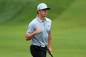 LOUISVILLE, KY - AUGUST 08:  Rory McIlroy of Northern Ireland celebrates an eagle putt on the 18th green during the second round of the 96th PGA Championship at Valhalla Golf Club on August 8, 2014 in Louisville, Kentucky.  (Photo by David Cannon/Getty Images)