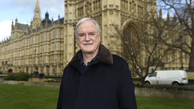 John Cleese has threatened to quit the UK after MPs voted against launching the second stage of the Leveson inquiry (Andrew Matthews/PA)