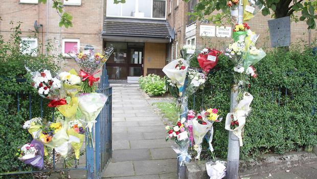 Floral tributes at the scene on Sunningdale Gardens in north Belfast were masked gunmen blasted Boreland. Picture: Sunday Life.