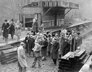 Prospective buyers pass the 'waiting room' at Knock Station, Belfast, as they look over old sleepers and other railway property which was up for auction.  15/12/1958