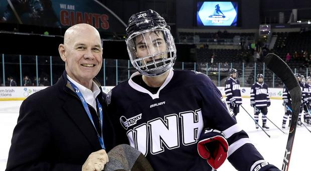 Ralph Cox (left) with UNH Wildcats' Liam Blackburn at this year's Friendship Four at the SSE Arena, Belfast (William Cherry/Presseye)