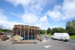Press Eye - Belfast - Northern Ireland - 8th July  A bonfire is prepared on the Milltown Road in south Belfast ahead of the 11th night bonfire celebrations which will take place across Northern Ireland this Monday night.   Picture by Jonathan Porter/PressEye