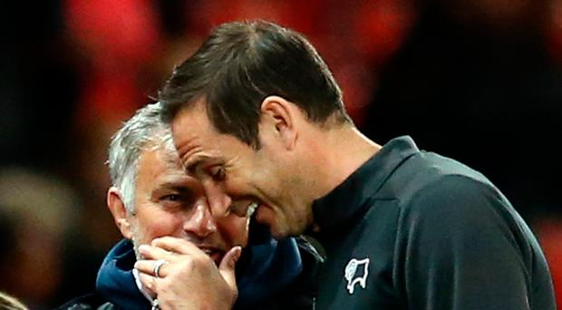 Respect: Frank Lampard, while Derby boss, shares a joke with then Manchester United chief Jose Mourinho