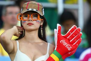The beautiful game - football fans from around the world -  : A fan looks on during the 2014 FIFA World Cup Brazil Group H match between Russia and South Korea at Arena Pantanal on June 17, 2014 in Cuiaba, Brazil.  (Photo by Adam Pretty/Getty Images)