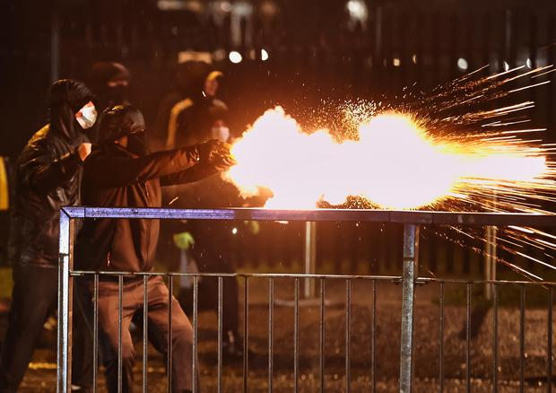 Youths discharge fireworks at the PSNI on the Springfield Road (Liam McBurney/PA)
