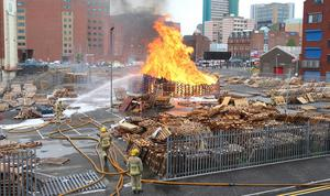 Picture - Kevin Scott / Presseye  Belfast - Northern Ireland - Thursday 25th June 2015 - Sandy Row Bonfire   Pictured is firefighters at the scene of the Sandyrow bonfire as it was set alight early on Thursday Morning    Picture - Kevin Scott / Presseye