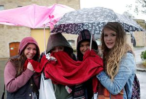 Sunday Life News Young One Direction fans huddle in under their umbrellas at the Culloden Hotel, Holywood. Picture Colm O'Reilly 09-03-2013