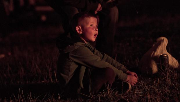 A young boy gazes in awe at a bonfire in the Roden Street area of south Belfast. Mark Marlow/Pacemaker Press.