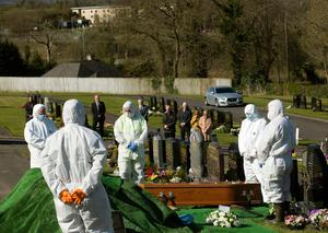Undertakers dressed in white hazmat suits at the grave side of Enniskillen man Lawrence McManus towards his grave at Cross Cemetery on Saturday. Picture by John McVitty and taken with the kind permission of the McManus family