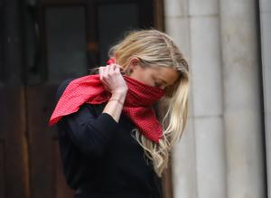 Actress Amber Heard leaves the High Court in London (Aaron Chown/PA)