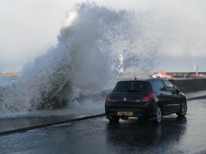 Parked car at Donaghadee getting a free wash Pic Derek Polwin