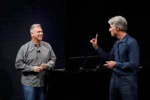 CUPERTINO, CA - OCTOBER 27: Apple Senior Vice President of Software Engineering Craig Federighi (R) gestures to Vice President of Worldwide Marketing Phil Schiller during a product launch event on October 27, 2016 in Cupertino, California. Apple Inc. is expected to unveil the latest iterations of its MacBook line of laptops (Photo by Stephen Lam/Getty Images)
