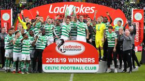 Different class: Celtic players celebrate after clinching the Scottish Premiership title last season