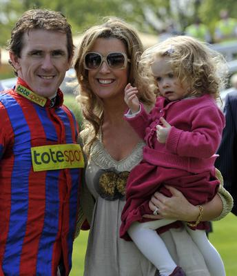 Horse Racing - The bet365 Gold Cup Meeting - Day Two - Sandown Racecourse...Champion jockey Tony McCoy, with wife Chanelle and daughter Eve during the bet365 Gold Cup Meeting at Sandown Racecourse, Surrey. PRESS ASSOCIATION Photo. Picture date: Saturday April 24, 2010. See PA story RACING Sandown. Photo credit should read: Rebecca Naden/PA Wire. ...S