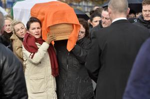 Mourners pictured at the removal of Sinn Feins Martin McGuinness to his home in the Bog side. Martin's wife Bernie pictured during her husband's removal. Photo by Stephen Hamilton / Press Eye.