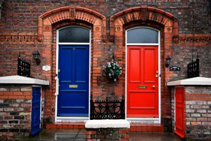 A red and blue door are seen next to each other near the stadium prior to the Premier League match between Liverpool and Everton at Anfield on April 1, 2017 in Liverpool, England.  (Photo by Gareth Copley/Getty Images)