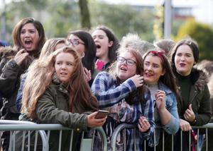 Press Eye - Belfast - Northern Ireland - 21st October 2015  One Direction fans queue up at the SSE Arena in Belfast ahead of tonight's concert.  The boy band, who are playing three nights in Belfast, cancelled last nights gig at the last minute.  The group made an announcement around lunch time to say they were going ahead with the rest of the shows and are rescheduling the canceled performance to Friday night.   Emotional fans after they hear the announcments that the rest of the shows are going ahead.  Picture by Jonathan Porter/PressEye