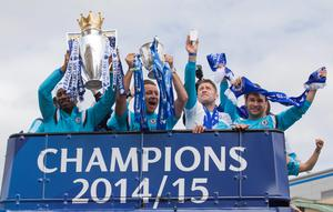 (L-R) Chelsea's Ivorian striker Didier Drogba holds up the Premier league trophy as Chelsea's English defender John Terry holds up the League cup while Chelsea's English defender Gary Cahill and Chelsea's Serbian defender Branislav Ivanovic cheer as they take part in an open-top bus parade to celebrate winning the league in west London on May 25, 2015.  AFP PHOTO / JUSTIN TALLISJUSTIN TALLIS/AFP/Getty Images