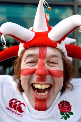 An England supporter shows his support ahead of the Rugby World Cup match at Twickenham Stadium, London.