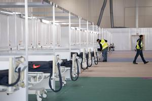 Soldiers and private contractors helped to turn the ExCel centre in east London into the new hospital (Stefan Rousseau/PA)