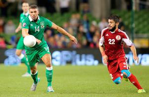 Republic of Ireland's striker Jon Walters (L) vies with Georgia's midfielder Georgi Navalovski during the Euro 2016 qualifying group D football match between Republic of Ireland and Georgia at Aviva Stadium in Dublin on September 7, 2015. Republic of Ireland won the game 1-0. AFP PHOTO / PAUL FAITHPAUL FAITH/AFP/Getty Images