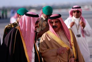 King of Bahrain, Hamad bin Issa al-Khalifa (R) welcomes Saudi King Salman bin Abdulaziz upon his arrival for the 37th on December 6, 2016 in the Bahraini capital Manama.  British Prime Minister Theresa May was to join Gulf Arab leaders at a summit in Bahrain for talks on trade after Britain's exit from the European Union. / AFP PHOTO / STRINGERSTRINGER/AFP/Getty Images