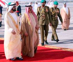 King of Bahrain, Hamad bin Issa al-Khalifa (R) welcomes the UAE Prime Minister Sheikh Mohammed bin Rashid al-Maktoum (L) upon his arrival for the 37th on December 6, 2016 in the Bahraini capital Manama.  British Prime Minister Theresa May was to join Gulf Arab leaders at a summit in Bahrain for talks on trade after Britain's exit from the European Union. / AFP PHOTO / STRINGERSTRINGER/AFP/Getty Images