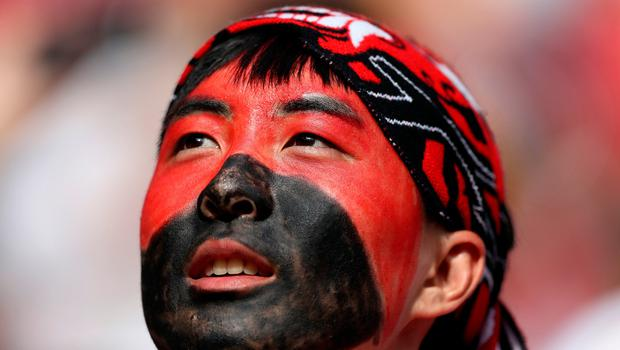 KAZAN, RUSSIA - JUNE 27:  A Korea Republic fan enjoys the pre match atmosphere prior to the 2018 FIFA World Cup Russia group F match between Korea Republic and Germany at Kazan Arena on June 27, 2018 in Kazan, Russia.  (Photo by Kevin C. Cox/Getty Images)