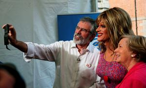 Drag queen and gay rights activist Rory O'Neill (centre), known by his stage name as Panti Bliss has his photo taken with Sinn Fein leader Gerry Adams and Minister for Justice and Equality Frances Fitzgerald (right) at the Central Count Centre in Dublin Castle, Dublin, as votes continue to be counted in the referendum on same-sex marriage. PRESS ASSOCIATION Photo. Picture date: Saturday May 23, 2015. Ireland is set to enshrine the right to gay marriage in a historic world first. Key campaign groups fighting the rights reform conceded defeat, with results from around the country indicating a two to one majority of voters backing the constitutional change. See PA story IRISH GayMarriage. Photo credit should read: Brian Lawless/PA Wire