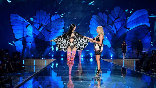 NEW YORK, NY - NOVEMBER 10:  Model Ming Xi from China walks the runway while singer Ellie Goulding performs during the 2015 Victoria's Secret Fashion Show at Lexington Avenue Armory on November 10, 2015 in New York City.  (Photo by Dimitrios Kambouris/Getty Images for Victoria's Secret)