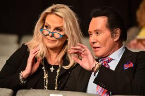 US entertainer Wayne Newton and wife Kathleen McCrone attend the third and final US presidential debate between Democratic nominee Hillary Clinton and Republican nominee Donald Trump at the Thomas & Mack Center on the campus of the University of Las Vegas in Las Vegas, Nevada on October 19, 2016. / AFP PHOTO / Paul J. RichardsPAUL J. RICHARDS/AFP/Getty Images