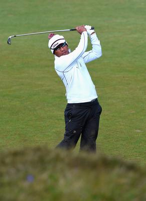 NEWCASTLE, NORTHERN IRELAND - MAY 29:  Thongchai Jaidee of Thailand hits his 2nd shot on the 13th hole during the Second Round of the Dubai Duty Free Irish Open Hosted by the Rory Foundation at Royal County Down Golf Club on May 29, 2015 in Newcastle, Northern Ireland.  (Photo by Ross Kinnaird/Getty Images)