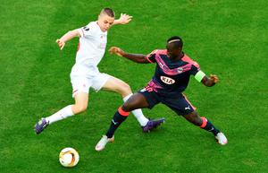 Liverpool's English midfielder Jordan Rossiter(L) vies with Bordeaux's French forward Henri Saivet (R) during the group B, UEFA Europa League football match between Bordeaux vs Liverpool on September 17, 2015 at the Matmut Atlantique Stadium in Bordeaux.  AFP PHOTO / MEHDI FEDOUACHMEHDI FEDOUACH/AFP/Getty Images