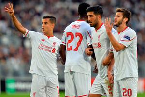 (L-R) Liverpool's Philippe Couthino, Divock Origi, Emre Can, and Adam Lallana react during the UEFA Europa League Group B football match Bordeaux vs Liverpool on September 17, 2015 at the Matmut Atlantique stadium in Bordeaux. AFP PHOTO / NICOLAS TUCATNICOLAS TUCAT/AFP/Getty Images