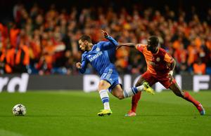 LONDON, ENGLAND - MARCH 18:  Eden Hazard of Chelsea evades Emmanuel Eboue of Galatasaray during the UEFA Champions League Round of 16 second leg match between Chelsea and Galatasaray AS at Stamford Bridge on March 18, 2014 in London, England.  (Photo by Mike Hewitt/Getty Images)