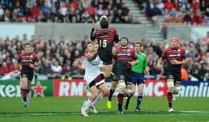 Jared Payne clashes with Alex Goode and sees red for this challenge during the Heineken Cup quarter final game between Ulster and Saracens at Ravenhill, Belfast. Photo: Pacemaker