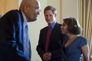 WASHINGTON, DC - MAY 09:  Prince Harry (C), along with wife of the British Ambassador to the US Lady Westmacott (R) and Democratic Representative from Michigan John Dingell (L) greet attendees before a reception in the Prince's honor at the Ambassador's residenceon May 9, 2013 in Washington, DC. HRH Prince Harry will be undertaking engagements on behalf of charities with which the Prince is closely associated on behalf also of HM Government, with a central theme of supporting injured service personnel from the UK and US forces. (Photo by Jim Lo Scalzo -Pool/Getty Images)