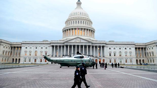 TOPSHOT - A military helicopter lands at the US Capitol on January 20, 2017 in Washington, DC. Donald Trump will be sworn in as the 45th president of the United States Friday -- capping his improbable journey to the White House and beginning a four-year term that promises to shake up Washington and the world. / AFP PHOTO / POOL / Rob CarrROB CARR/AFP/Getty Images