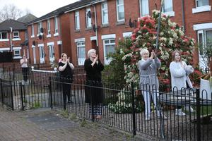 Residents from East Belfast join the clap for the Carers and NHS staff battling the Covid-19 outbreak. Photo by Peter Morrison