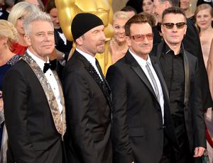 HOLLYWOOD, CA - MARCH 02:  (L-R) Musicians Adam Clayton, The Edge, Bono, and Larry Mullen Jr. of U2 attend the Oscars held at Hollywood & Highland Center on March 2, 2014 in Hollywood, California.  (Photo by Michael Buckner/Getty Images)