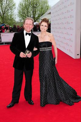 John Culshaw and Emma Samms arriving for the 2013 Arqiva British Academy Television Awards at the Royal Festival Hall, London. PRESS ASSOCIATION Photo. Picture date: Sunday May 12, 2013. See PA story SHOWBIZ Bafta. Photo credit should read: Ian West/PA Wire
