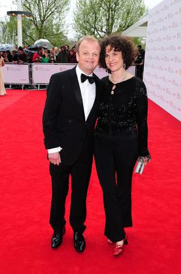 Toby Jones and guest arriving for the 2013 Arqiva British Academy Television Awards at the Royal Festival Hall, London. PRESS ASSOCIATION Photo. Picture date: Sunday May 12, 2013. See PA story SHOWBIZ Bafta. Photo credit should read: Ian West/PA Wire