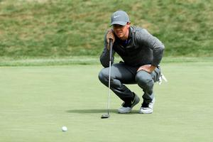 NORTON, MA - SEPTEMBER 05:  Rory McIlroy of Northern Ireland lines up a putt on the 17th green during the final round of the Deutsche Bank Championship at TPC Boston on September 5, 2016 in Norton, Massachusetts.  (Photo by David Cannon/Getty Images)
