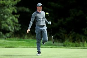 NORTON, MA - SEPTEMBER 05:  Rory McIlroy of Northern Ireland reacts to his shot on the 14th tee during the final round of the Deutsche Bank Championship at TPC Boston on September 5, 2016 in Norton, Massachusetts.  (Photo by David Cannon/Getty Images)