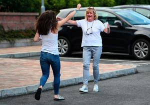 Emer Maguire who got 3 A* celebrates with her mother Ciara Maguire after collecting her A-level results at Our Lady and Saint Patrick's College, Belfast. Brian Lawless/PA Wire