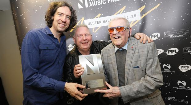 Gary Lightbody presents Steve Strange with the 'Outstanding contribution to music award' pictured with his dad Wesley Strange (88)