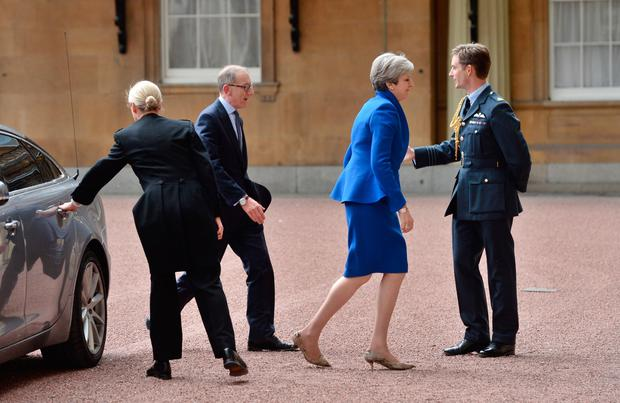 Prime Minister Theresa May with her husband Philip arrives at Buckingham Palace where she will seek the Queen's permission to form a UK government on June 9, 2017 in London, England.  (Photo by Victoria Jones - WPA Pool/Getty Images)