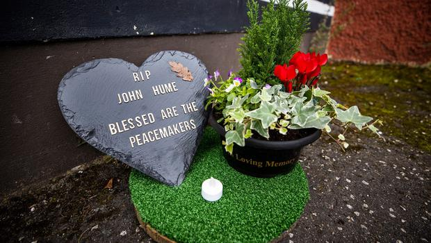 Tributes left in front of a mural in the Bogside of Derry City that shows John Hume, one of the key architects of peace in Northern Ireland, after his death at the age of 83. PA Photo. Picture date: Monday August 03, 2020. See PA story DEATH Hume. Photo credit should read: Liam McBurney/PA Wire